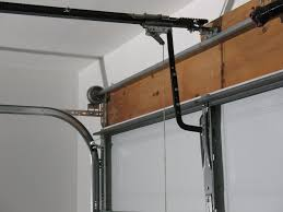 image of garage door torsion spring install