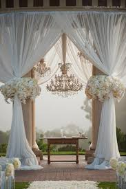 image sources 1 2 if your venue is more like an open field consider bringing a tent or gazebo frame to hang the chandeliers