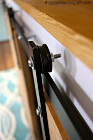the barn door hardware is fairly simple pieces you can find at any big home improvement aluminum bars with 1 1 2 pulley wheels