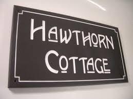 custom house sign with decorative border