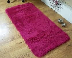 fuschia hot pink faux fur sheepskin style oblong rug 70 x