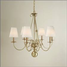 brass chandelier a modern take on the antique with scrolling arms and a