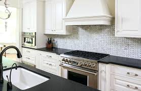 white granite backsplash kitchen with black granite counter and white tile and white cabinetry river white white granite backsplash granite ideas