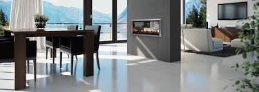 double sided escea dx1000 gas fireplace in a grey statement wall separates dinning and lounge