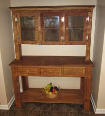 small barn wood corner cabinet with 3 drawer hunt board and bottom shelf also 3 glass door top on brown tile floor