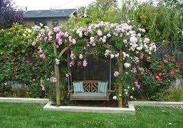 grab garden arbor swing with flowers picture