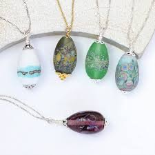 lampwork glass egg pendant necklace on sterling silver and gold