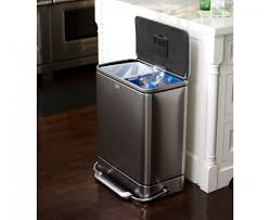 small stinless steel decorative kitchen trash cans under white marble countertop kitchen island and black rubber floor mat on varnished hardwood kitchen