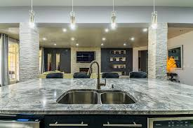 kitchen island with super white marble as the surface and undermount sink