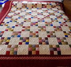 Our Amish made Nine Patch Calico Quilt is full of surprising color ... & Our Amish made Nine Patch Calico Quilt is full of surprising color, offset  by spaces Adamdwight.com