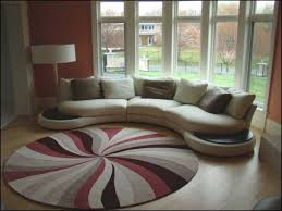 living room decorating with area rugs on hardwood floors arm chairs white cabinet impressive wall