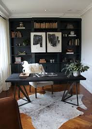 gorgeous office e inspiration rich wood faux fur rug and deep black shelving