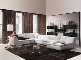 interior dark brown fabric curtains and l white fabric sofa on dark brown rug connected