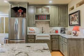 marble countertops and stainless steel kitchen appliances will make any chef feel at home
