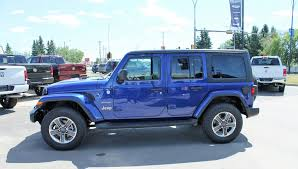 blue ocean blue metallic 2018 jeep wrangler unlimited left side photo in cold lake