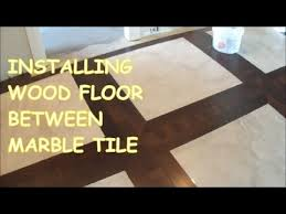 how to install prefinished hardwood floor around tile marble tile and wood floor togeather you