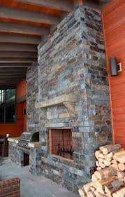 moose mountain ashlar 2 3 thick 4 heights with highlands hearth and mantle modern stone rock fireplace mantle bbq outdoor living