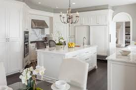 stunning white corner kitchen pantry cane back isalnd stools side by side fridges french crystal chandeliers