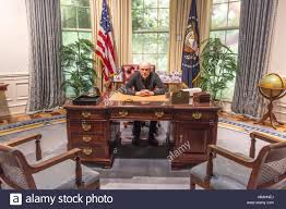 oval office desk. FEBRUARY 28, 2018 - COLLEGE STATION TEXAS George H.W. Bush Presidential Library And Museum Shows Oval Office Photographer Joe Sohm Sitting At Desk