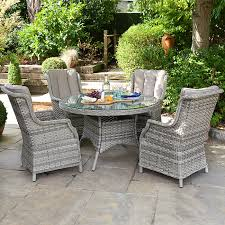 oyster 4 seat rattan dining set 1 2m round table oyster 4 seat rattan garden dining set zebrano