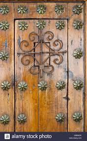 door knocker and decoration on very old door in ronda andalucia spain