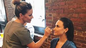 in honor of demi lovato s sixth studio al tell me you love me hitting s on sept 29 her makeup artist jill powell dropped by et for a new