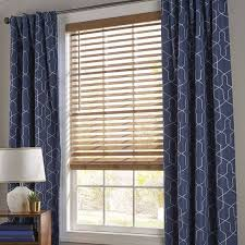 how to hang curtains over blinds