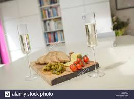 kitchen counter with food. Champagne Flutes And Food On Kitchen Counter With D