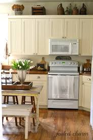 Cream Cabinets With White Appliances