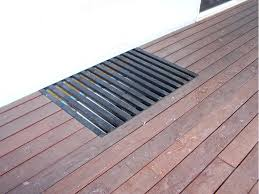 deck floor covering ideas solution to bring light to basement windows under a deck