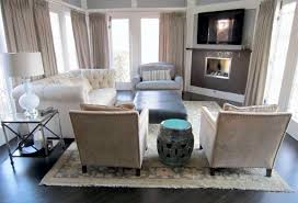 grey walls living room corner breakfast nook rod as wel dark grey sofa wooden floor soft brown curtain