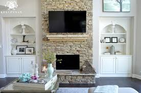 stacked stone fireplace with built ins fresh in cabinets next to cool tone spring ready living room tour kelley nan
