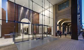 Glass facade design office building Angle Shot Redesign Of The 116 Huntington Building In Boston Transformed Stretch Of The Avenue By Introducing Inviting And Visible Retail Spaces Welllit And Commercial Architecture Magazine Four Factors Lead To Urban Revitalization Commercial Architecture