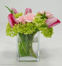 wedding centerpieces 032 beautiful centerpiece with pink tulips and pink roses accented with green hydrangea in a clear square glass vase