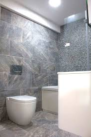 A modern bathroom display with stone effect porcelain tiles and modern  bathroom furniture on display in