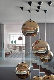 Lighting Design Metallic Bubble Pendant Lights Clustered Together