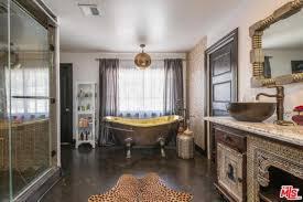 the bathroom has an elegant looking bathtub shower room and classy sink