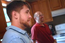 u s department of defense photo essay mario giunta stands his father steve in their kitchen in hiawatha iowa