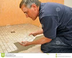 laying tile in bathroom. Man Installing Ceramic Tile In Bathroom Laying I