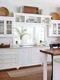 woven baskets make up the abovecabinet decor in this kitchen decorating tops of kitchen cabinets t73 kitchen