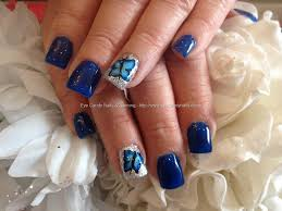 gel nail designs for fall 2014. gel nails with blue polish and butterfly on ring fingers #nailart # nail designs for fall 2014 j