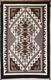 picture of two grey hills navajo rug ey