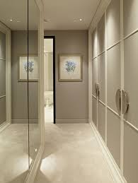 Lengthen And Expand A Narrow Hallway By Lining One Side With Mirrors