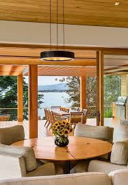 modern tropical furniture. Modern Tropical Dining Room With Wood Round Table Frosted Glass Shade Furniture .