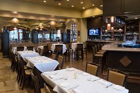 the dining area of ferraro s italian restaurant wine bar at 4480 paradise rd in