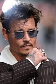 джонни депп дважды исправил татуировку на руке