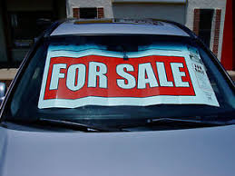 For Sale Sign On Car