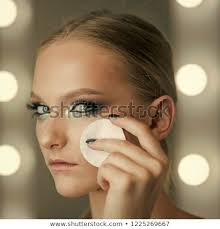 makeup application or removal woman use cotton pad for cleaning face skin beauty model