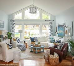 a white lofted ceiling and pale blue walls give lightness to this living room