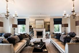 antique mirror design living room traditional with two chandeliers velour couches velour couches
